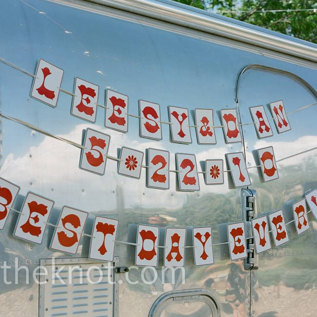 There were two Airstream trailers on the property that Leesy and Dan incorporated into their wedding decor. Dan made paper banners to hang on the side.