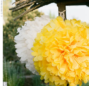 Aside from the hanging yellow and white paper flowers used to decorate both the ceremony space and the lounge area, the couple used little extra decor.