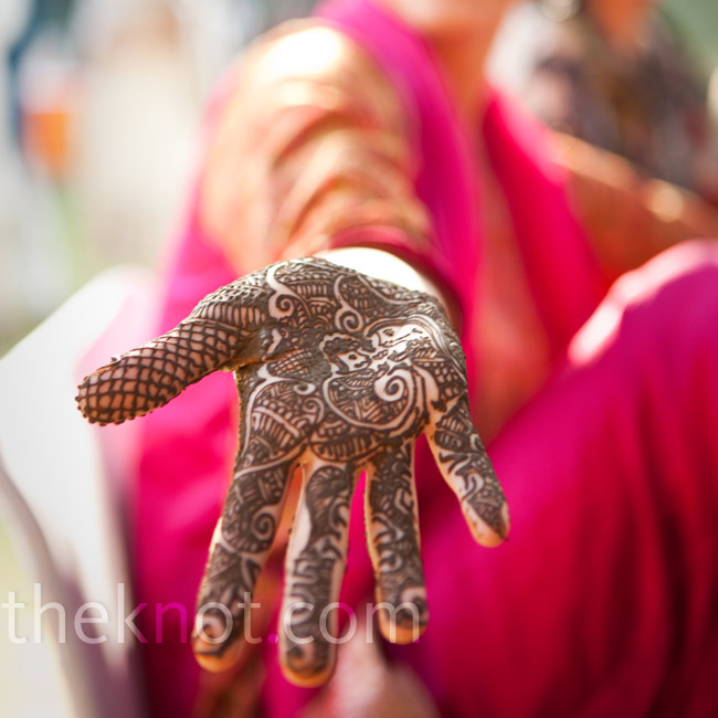 Kristin had an image of a man and a woman (symbolizing husband and wife) drawn onto her hand. Jaidev's name was hidden in the pattern -- tradition says that if the husband cannot find his name, he has to pay his new wife money. Fortunately for Jaidev, he found his name almost immediately.