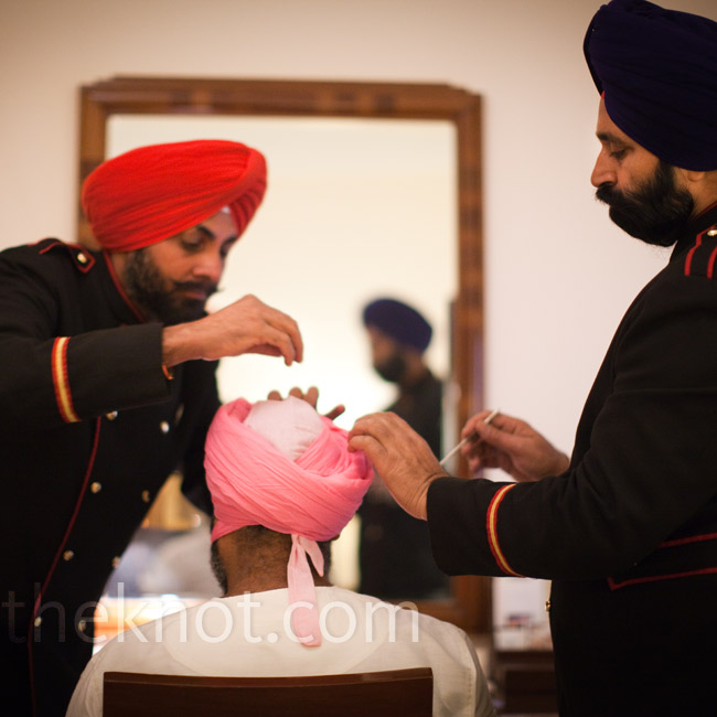 Two hotel employees had to assist Jaidev in tying on his wedding turban. Pink and red are popular wedding colors in New Delhi.