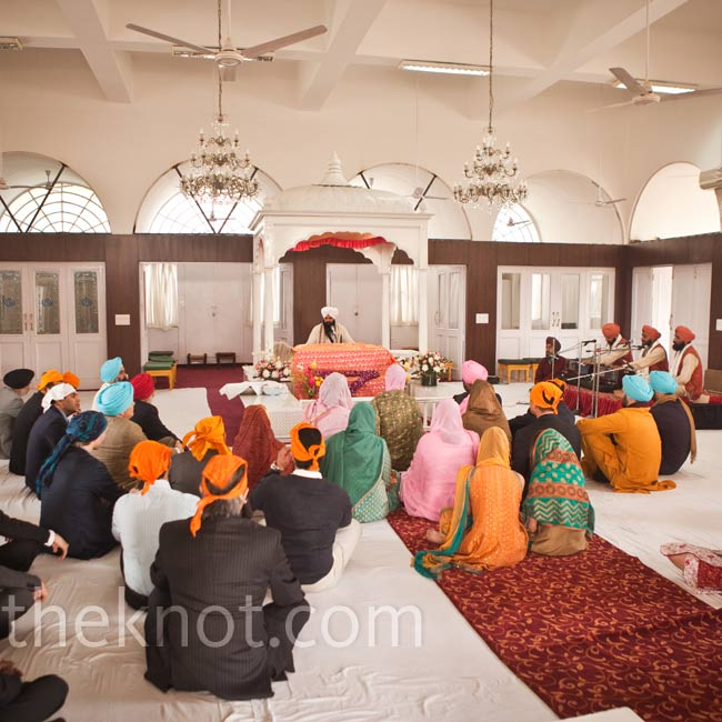 Inside the temple, guests sat in front of the Granthi, who read from the Guru Granth Sahib, or Sikh's holy book. Before entering the gurdwara, everyone is required to remove their shoes and cover their head.