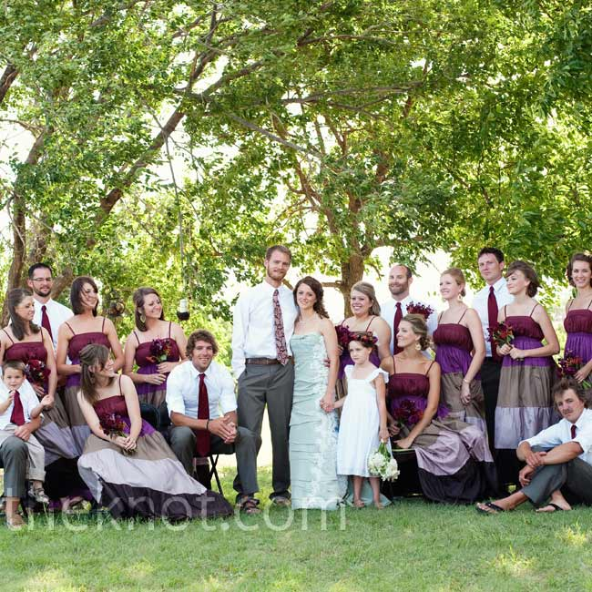 The bridesmaids' breezy satin dresses were perfect for the August weather, and the bold purple, champagne, pearl, and chocolate-brown stripes fit perfectly into the wedding's color scheme. The guys' wine-colored ties kept them in theme.