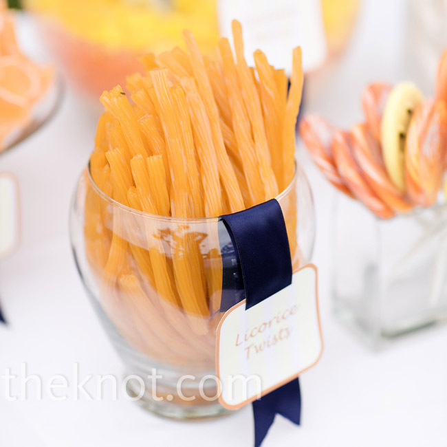 Taking inspiration from candy buffets she saw in The Knot magazine, Anda created a bright orange snack bar with orange candies and other treats, like Cheetos.