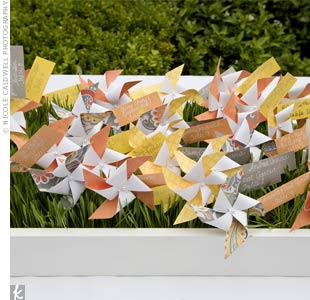Brightly colored pinwheels were tagged with seating assignments and planted in a bed of wheatgrass.