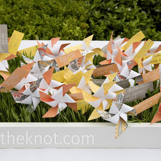 "Brightly colored pinwheels were tagged with seating assignments and ""planted"" in a bed of wheatgrass."