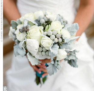 Ashley carried a wintery mix of roses, peonies, gray berries and baby pinecones.