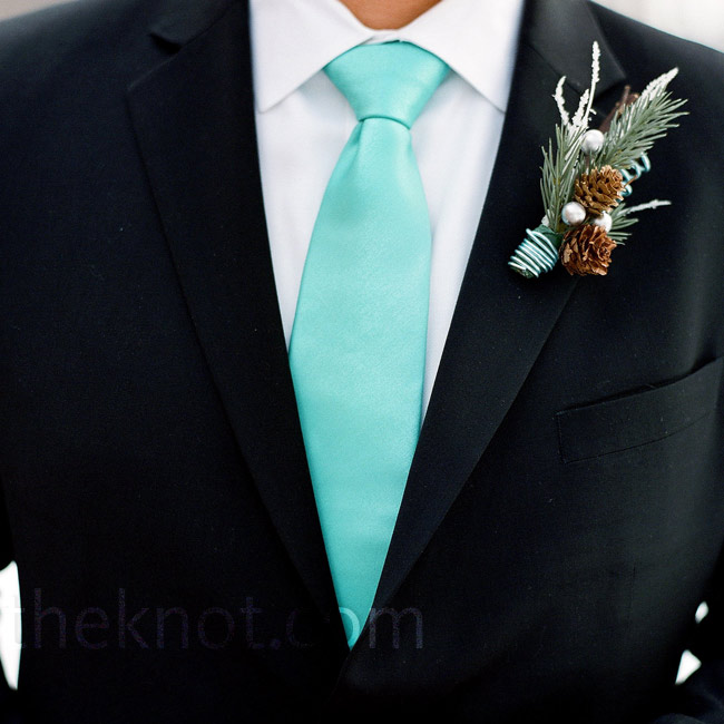 Patrick wore a tiny arrangement of twigs, pinecones and gray berries.