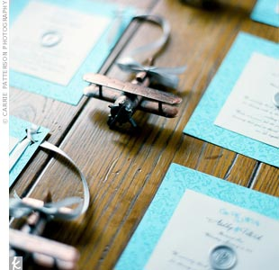 The couple attached bronze diecast airplane pencil sharpeners to aqua thank you cards that guests picked up as they left the reception.