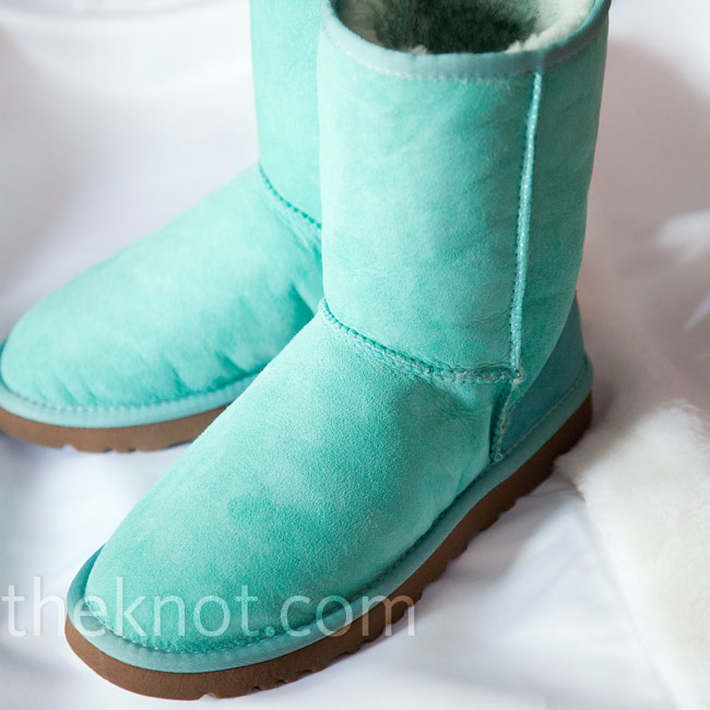 As soon as the couple decided on a snowy city for their wedding, Ashley picked out a pair of aqua-colored Uggs to wear under her gown.