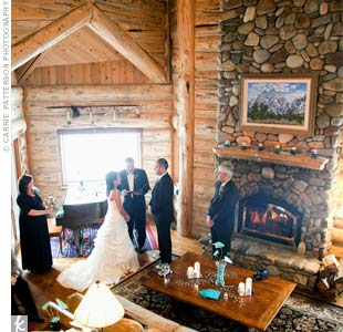 Ashley and Patrick said their vows in the Great Room of the Bentwood Inn between the piano and the fireplace. Silver pillar candles and aqua model airplanes were scattered on the piano and the mantel for extra decor.