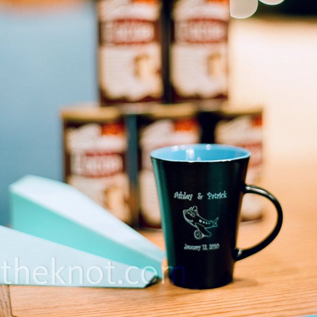 Ashley and Patrick threw a hot chocolate social instead of a rehearsal dinner. The guests left with coffee mugs engraved with the couple's names, the wedding date, and an airplane graphic.