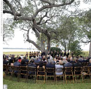 The couple exchanged vows under a tree by the river at Lowndes Grove.
