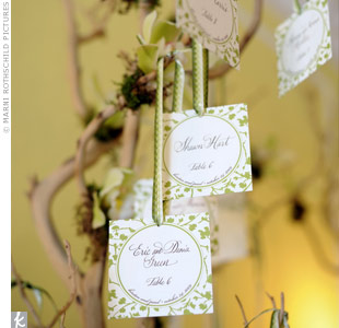 Cards with a leaf-motif hung from tree branches and directed guests to their seats.