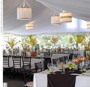 The dinner tent was white chiffon with hanging chandeliers. Candles and vases of burnt orange flowers decorated the tables.