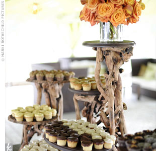 A stand (with branches as pillars) displayed cupcakes of various tasty flavors, such as lemon, pecan and Lady Baltimore, a traditional Charleston wedding cake.