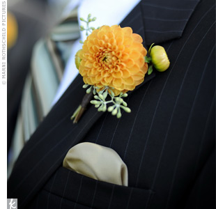 The groomsmen wore a single orange vanda orchid.
