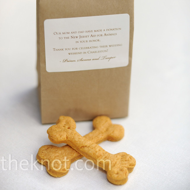 The couple handed out bags of dog biscuits for their friends' pups who couldn't be there in person.