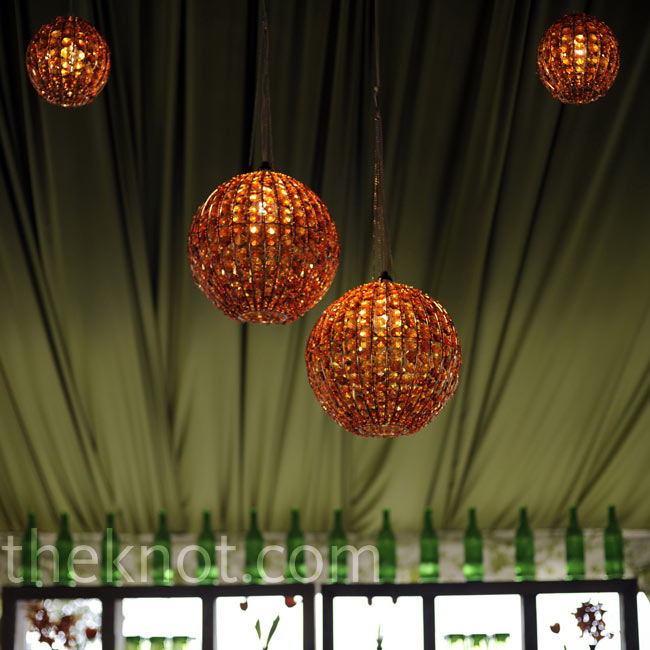 In addition to the dinner tent, a second tent was draped in green fabric and filled with brown couches, a bar and orange chandeliers to create a quiet place for guests to relax.