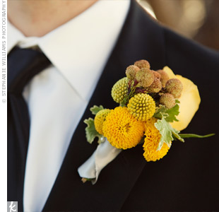 The florist used a mixture of mums, billy balls, and other yellow blooms to create the guys' sunny boutonnieres.