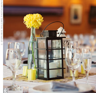 "In honor of Dana Point's ""lantern streets"" the couple used vintage-style lanterns to decorate each reception table."