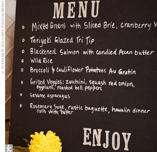 A chalkboard sign informed guests what was offered at the buffet, and a single bright yellow bud added some color.