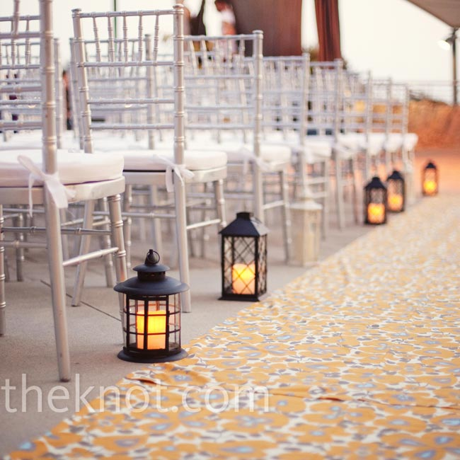 The aisle was lined with Amy Butler fabric and lanterns in varying styles, which gave off a warm, yellow glow.