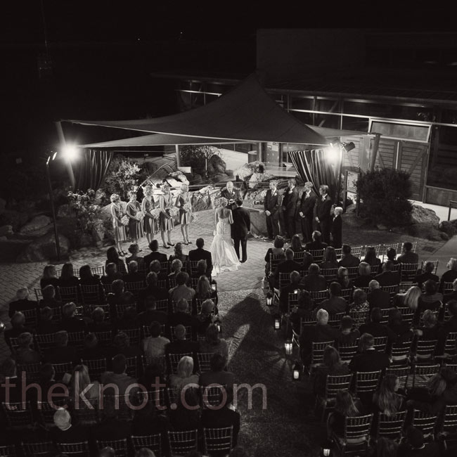 The ceremony took place outside the courtyard in view of the ocean under a gray canopy.