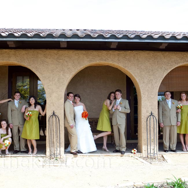 The bridesmaids brought the olive green into the wedding palette with silk taffeta dresses in varying styles to fit their personalities. The groomsmen matched the look with tan suits and green striped ties while Dan wore a tie with orange stripes.