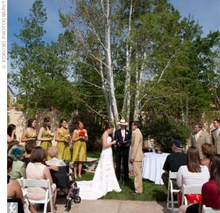 The ceremony was held outside in a courtyard surrounded by lush green lawn and Aspen trees.