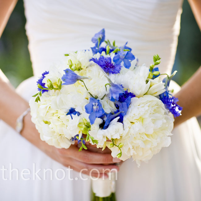 Blue cornflowers and delphiniums laced throughout Jenna's bouquet gave her white hydrangeas and peonies pops of color, and also matched the other floral arrangements of the day.