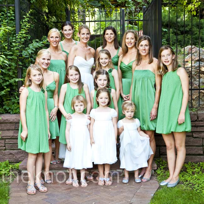 Jenna's six bridesmaids complemented the color scheme with three different knee-length styles from the Vineyard Collection. Six junior bridesmaids wore green bubble dresses with white polka dots and the flower girls rounded out the look with white Empire-waist dresses.