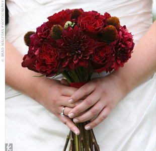The bride carried a rich, all-red bouquet of dahlias, roses, and cone flowers.