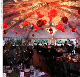 Gobo lighting bounced off of red and white paper lanterns, reflecting natural patterns against the white of the tent.