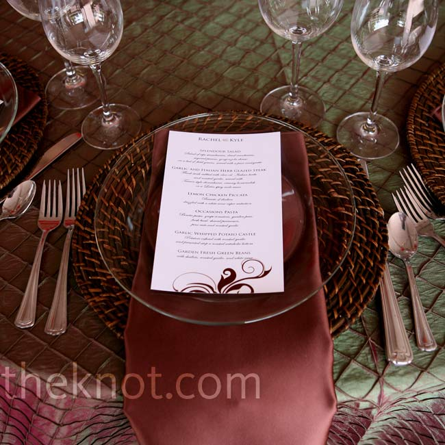 Dark wicker chargers behind clear glass plates gave the brown and green iridescent table linens an organic touch.
