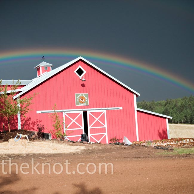 "A brief rain shower delayed the outdoor ceremony by about 15 minutes, but when it stopped a rainbow appeared over a field behind the barn where the ceremony was to be held. ""It was completely magical,"" says Amber."