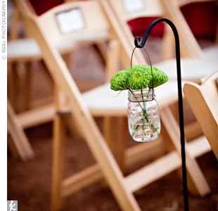 Bright green mums were loosely gathered in Mason jars and hung from shepherd's hooks along the aisle.
