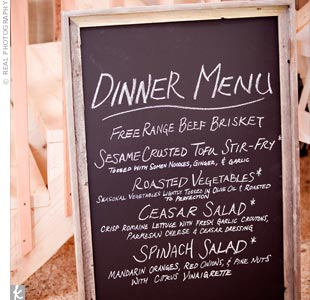 To complement the rustic surroundings, the couple displayed their menu on a chalkboard for guests to see as they entered the barn.