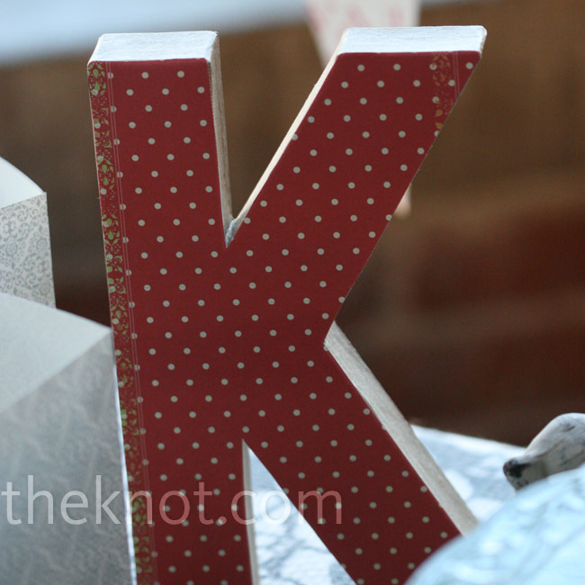 Deborah and Micah used a large wood block monogram with red polka dots to personalize one of their dessert bars.