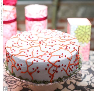 Deborah and Micah cut into one of three non-traditional wedding cakes, which were decorated to mimic the branches and the pattern on the groomsmen's ties.