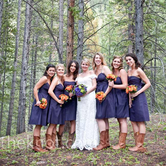 Like the bride, the six bridesmaids styled their looks to match the surroundings, wearing cowboy boots with their plum-colored taffeta dresses.