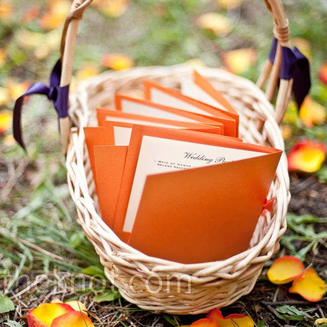 "Jessica ordered the tangerine bi-fold programs from a website that specialized in recycled papers. ""I loved that they had texture and beautiful colors,"" says the bride."