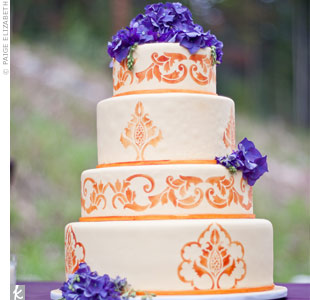 Purple hydrangeas and a bit of orange stenciling brought the wedding colors together on the red velvet (the bride's favorite flavor!) wedding cake.