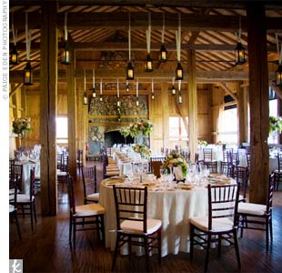 The dark woods and rustic details of Devil's Thumb Ranch contrasted nicely with the soft pinks, greens, and oranges in the wedding palette.