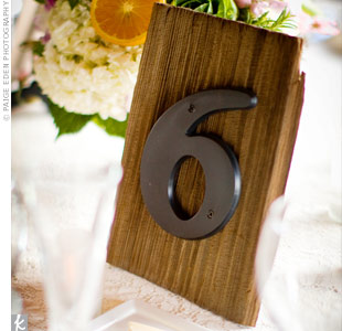 Vintage address numbers were used to make rustic, mismatched table numbers.