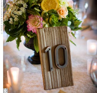 Vintage address numbers were used to make rustic, mismatched table numbers
