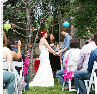 "The couple exchanged vows in the yard of Ria's home away from home (she's originally from Ireland) while she was interning for the non-profit, Seeking Common Ground. ""I had been staying with the founder's family and had been working there since I was 18,"" she says."