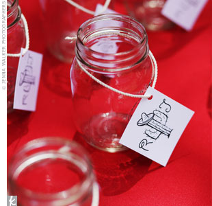 Mason jars, customized with tags bearing the couple's initials next to a sombrero-wearing cactus, kept guests from getting thirsty and also served as favors at the end of the night.