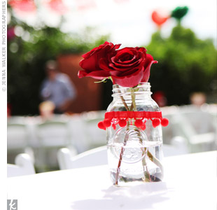 Butcher paper table covers allowed guests to doodle while Mason jars filled with red roses kept the look pretty, but casual.