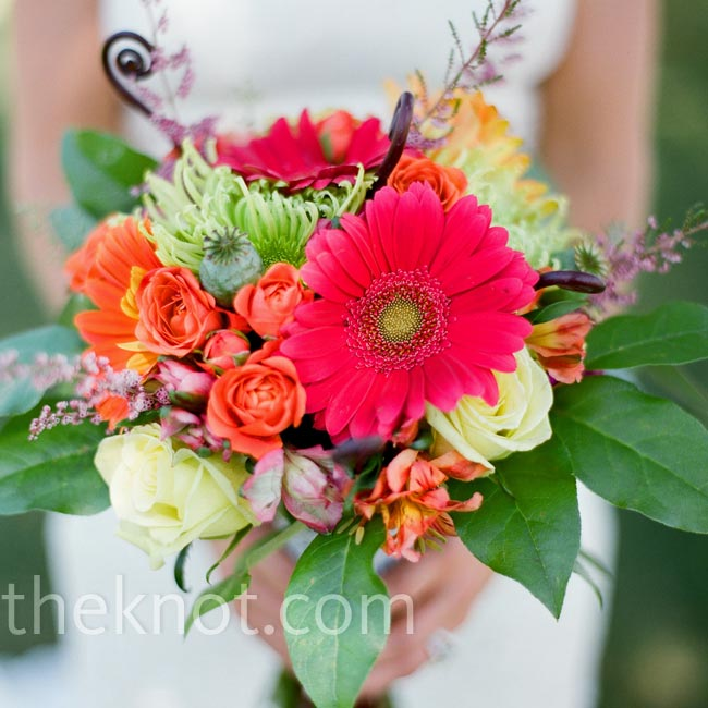 Erin's orange, pink, and green bouquet was wrapped with a white prayer flag that the couple had picked up in Nepal.