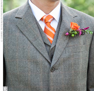 The guys matched the bouquets with orange rose boutonnieres accented with green hypericum berries, fiddlehead ferns, and purple stock. Bright purple wire held the bouts together.